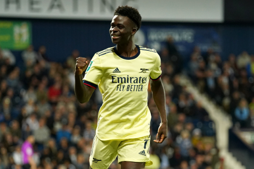 Arsenal's Bukayo Saka celebrates scoring their side's fourth goal of the match during the Carabao Cup second round match at The Hawthorns, West Bromwich.