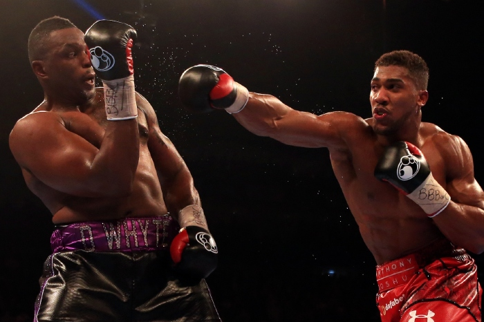 Anthony Joshua throws a right-hook towards fellow Londoner Dillian Whyte in their grudge match