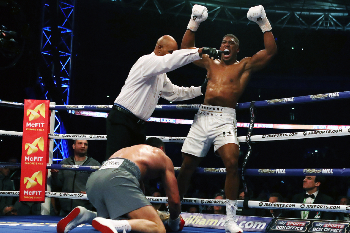 Anthony Joshua lifts his arms in victory after stopping Wladimir Klitschko in their classic fight at Wembley