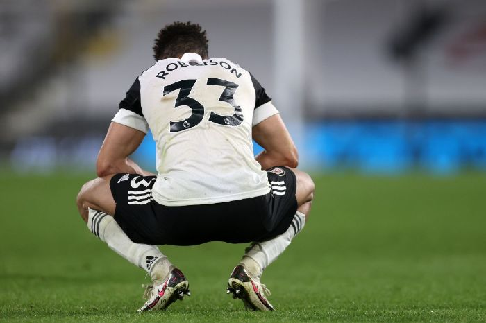 Antonee Robinson cut a dejected figure on Monday after Fulham's relegation was confirmed against Burnley