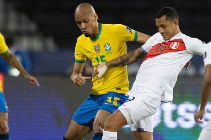 Fabinho wrestles for the ball against Peru in Group B