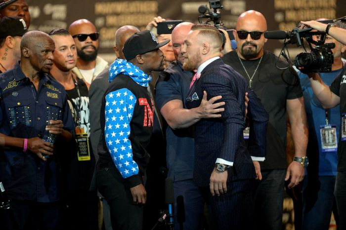 Floyd Mayweather faces off with Conor McGregor ahead of their crossover boxing match in 2017.