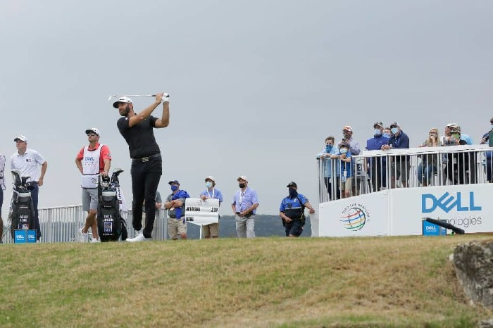 Dustin Johnson tees off on day one