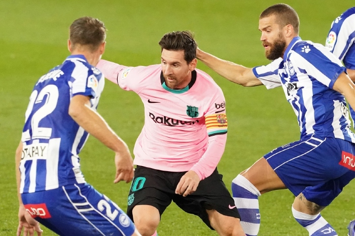 Lionel Messi battles with Alaves players in La Liga