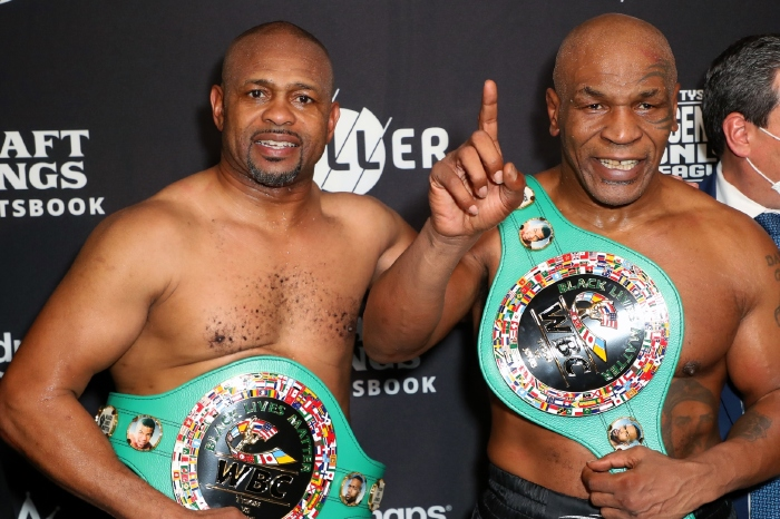 Mike Tyson alongside Roy Jones Jr after their exhibition bout in November 2020.