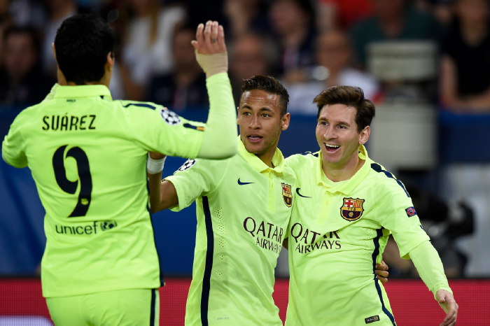 Suarez celebrating scoring against PSG in the Champions League