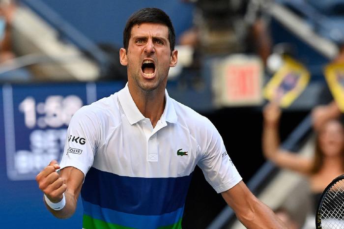 Novak Djokovic celebrates at US Open