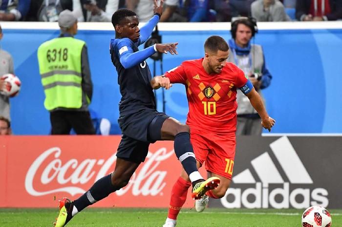 Paul Pogba and Eden Hazard contest the ball