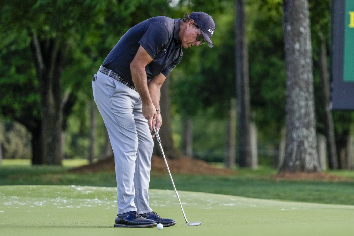 Mickelson leads by two.