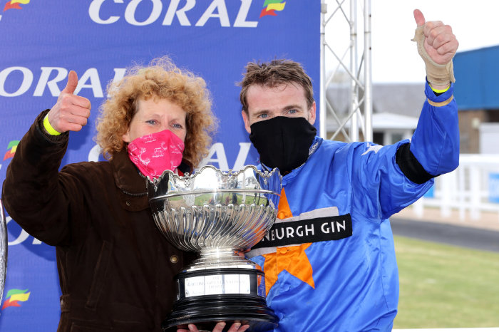 Lucinda Russell and Tom Scudamore with Scottish Grand National trophy
