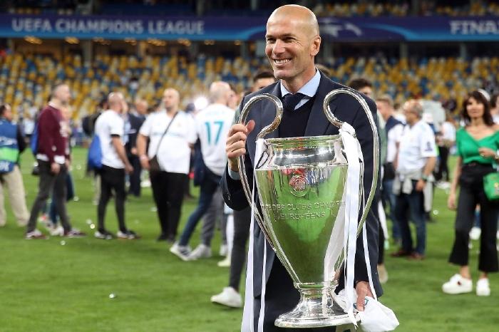 Zinedine Zidane with one of his many trophies
