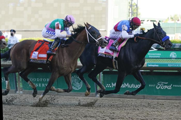 Medina Spirit edged Mandaloun to win the 2021 Kentucky Derby
