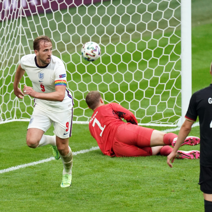 Harry Kane scores England's second against Germany, provoking wild reactions in the stands, and on the sidelines