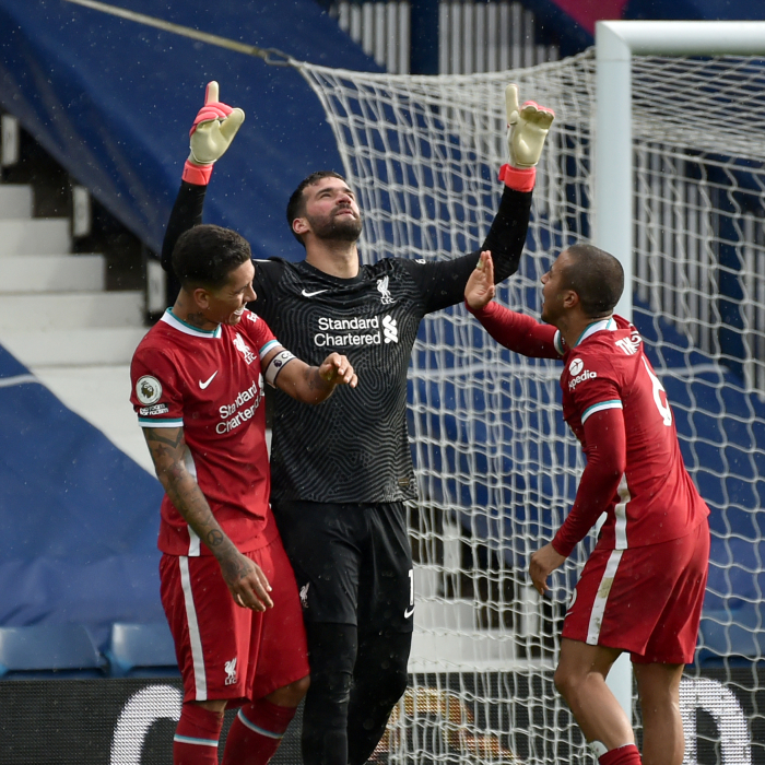 Alisson celebrates becoming the latest member of the goalscoring goalkeepers club