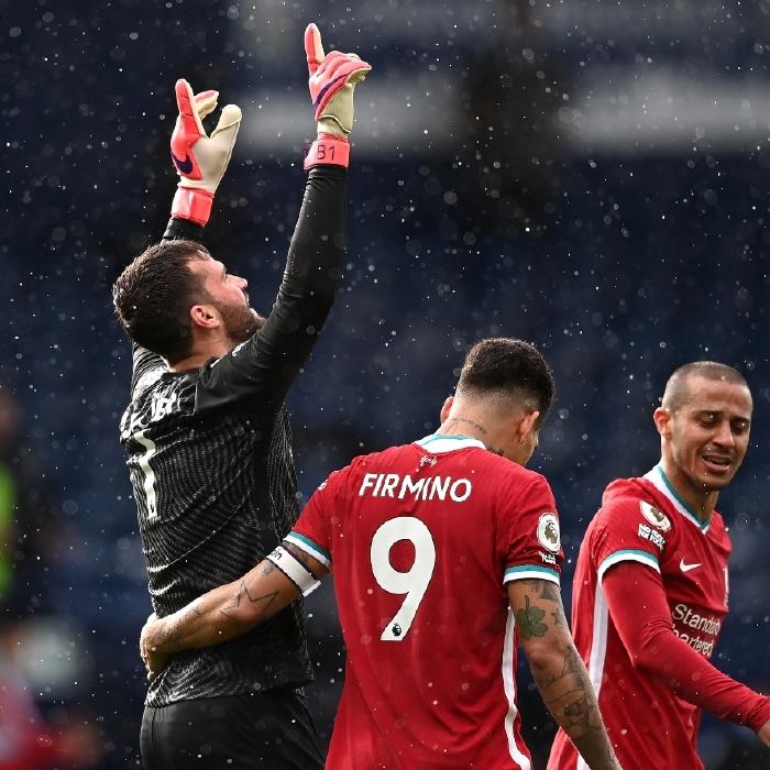 Alisson celebrates his winning goal against West Brom
