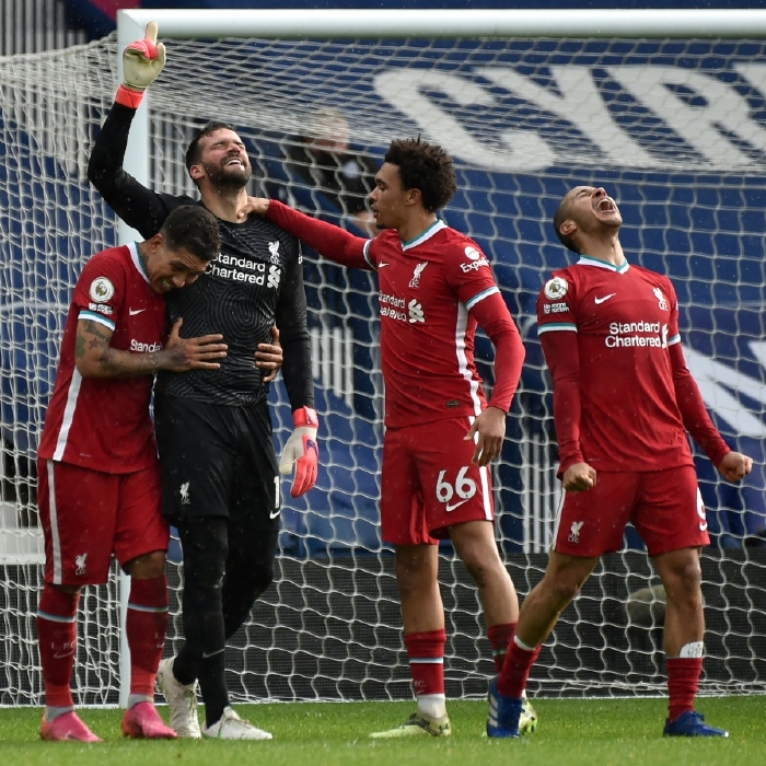 Alisson celebrates his late, late matchwinner against West Brom