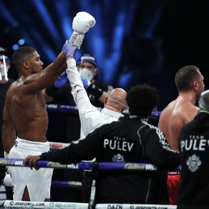 Anthony Joshua celebrates beating Kubrat Pulev