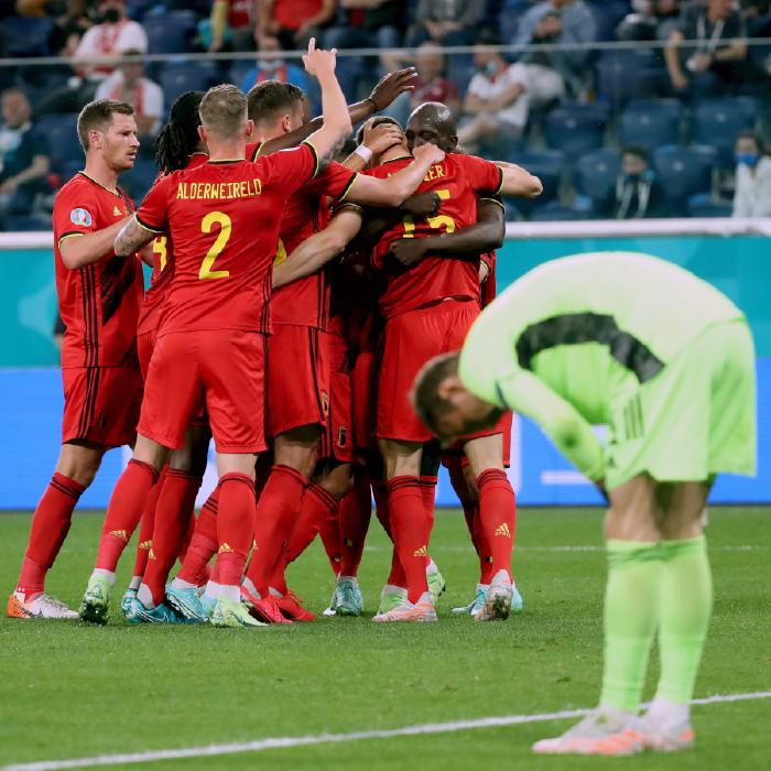Belgium players celebrate scoring against Russia