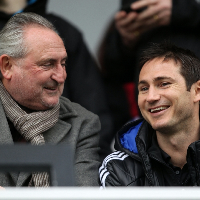 Frank Lampard Sr and Frank Lampard Jr enjoy a joke in the stand at Stamford Bridge