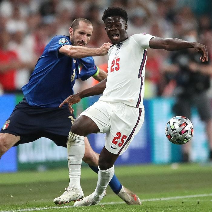 Giorgio Chiellini gets to grips with Bukayo Saka at Wembley