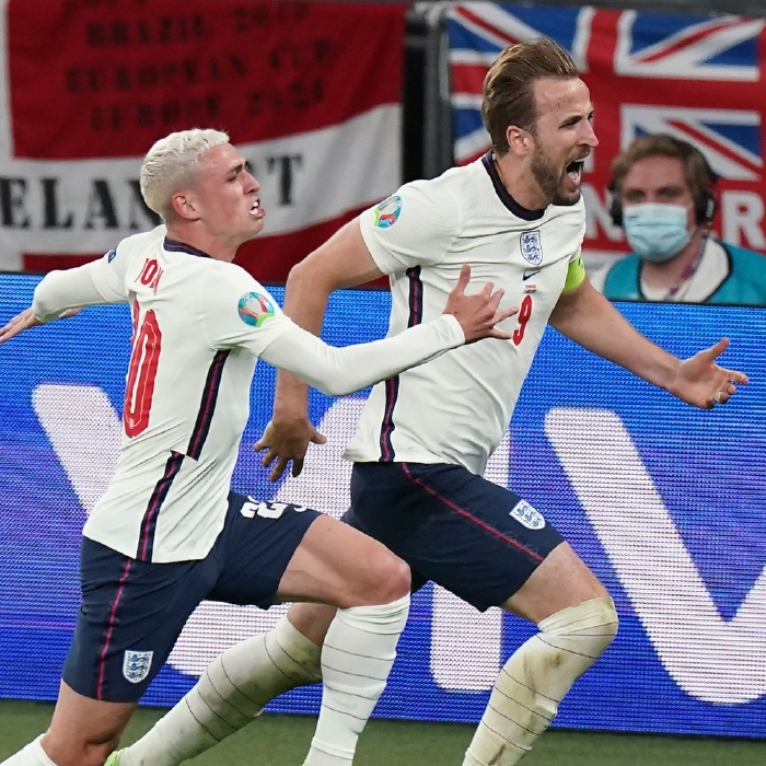 Harry Kane celebrates his winner against Denmark with Phil Foden