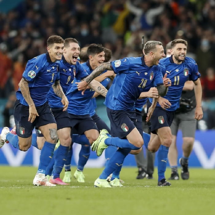 Italian players celebrate their shootout success over Spain