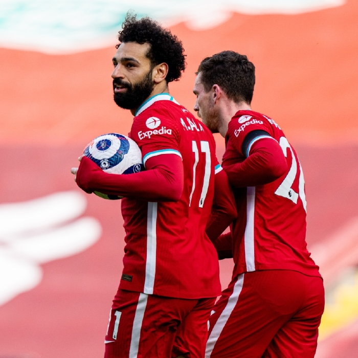 Mohamed Salah collects the ball after scoring for Liverpool, 2021