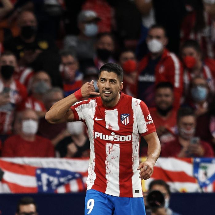 Luis Suarez celebrates scoring against his former side, Barcelona