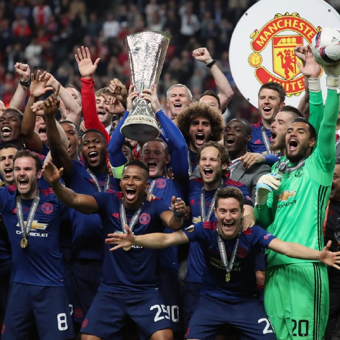 Wayne Rooney lifts the Europa League trophy with Manchester United in 2017