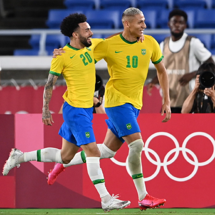Richarlison celebrates with Claudinho during Brazil's 4-2 win over Germany