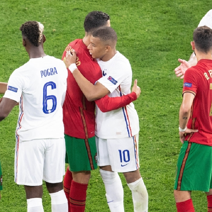 Cristiano Ronaldo and Kylian Mbappe embrace at the final whistle