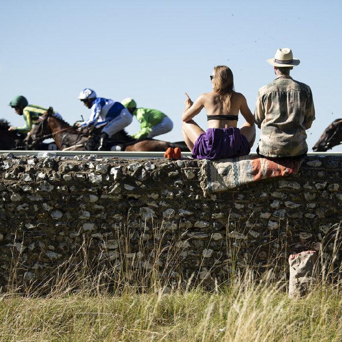 Racegoers watch on at Goodwood