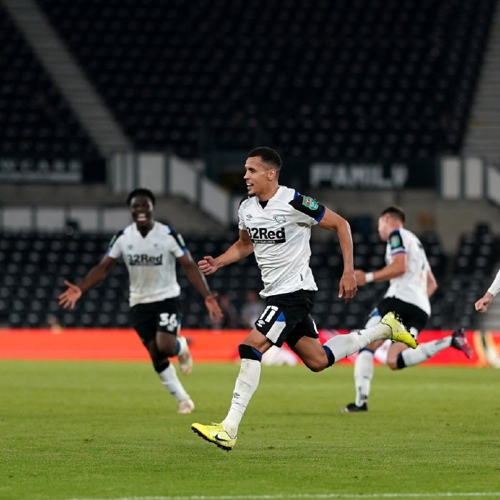 Ravel Morrison wheels away in celebration after scoring for Derby County against Salford City