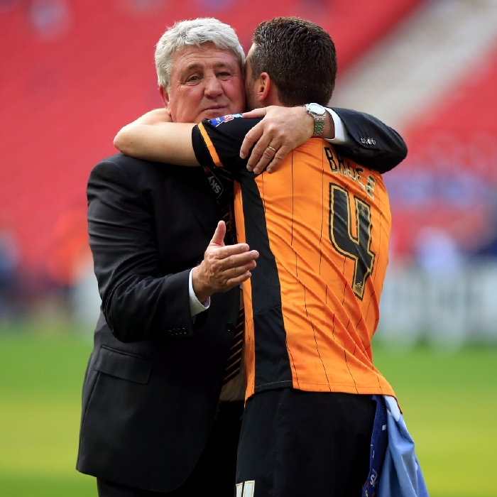 Steve Bruce and his son Alex celebrate a play-off final win while at Hull City
