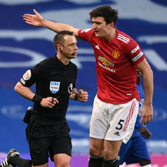 Harry Maguire remonstrates with Stuart Attwell after he failed to award a penalty for Manchester United in their clash with Chelsea