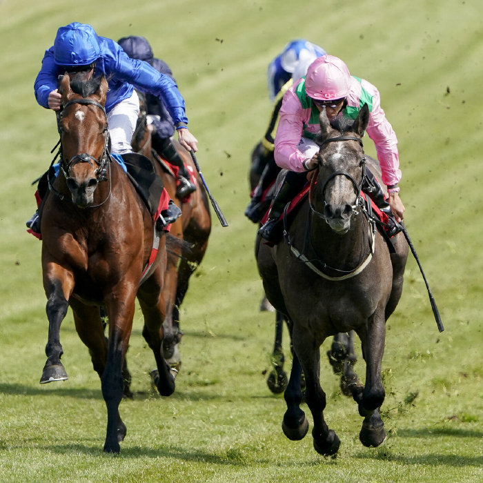 William Buick riding Wirko (left) wins The Blue Riband Trial at Epsom